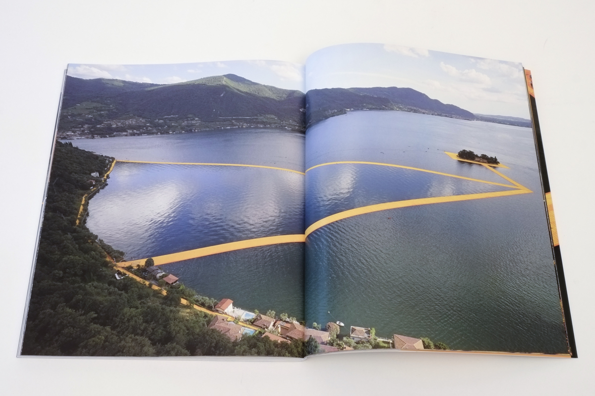idolatry moments - visitors taking pictures of the barge from which the artist, during one of his numerous daily tours, greets them. Christo & Jeanne-Claude - The Floating Piers - 2014-2016, pp. 114-115