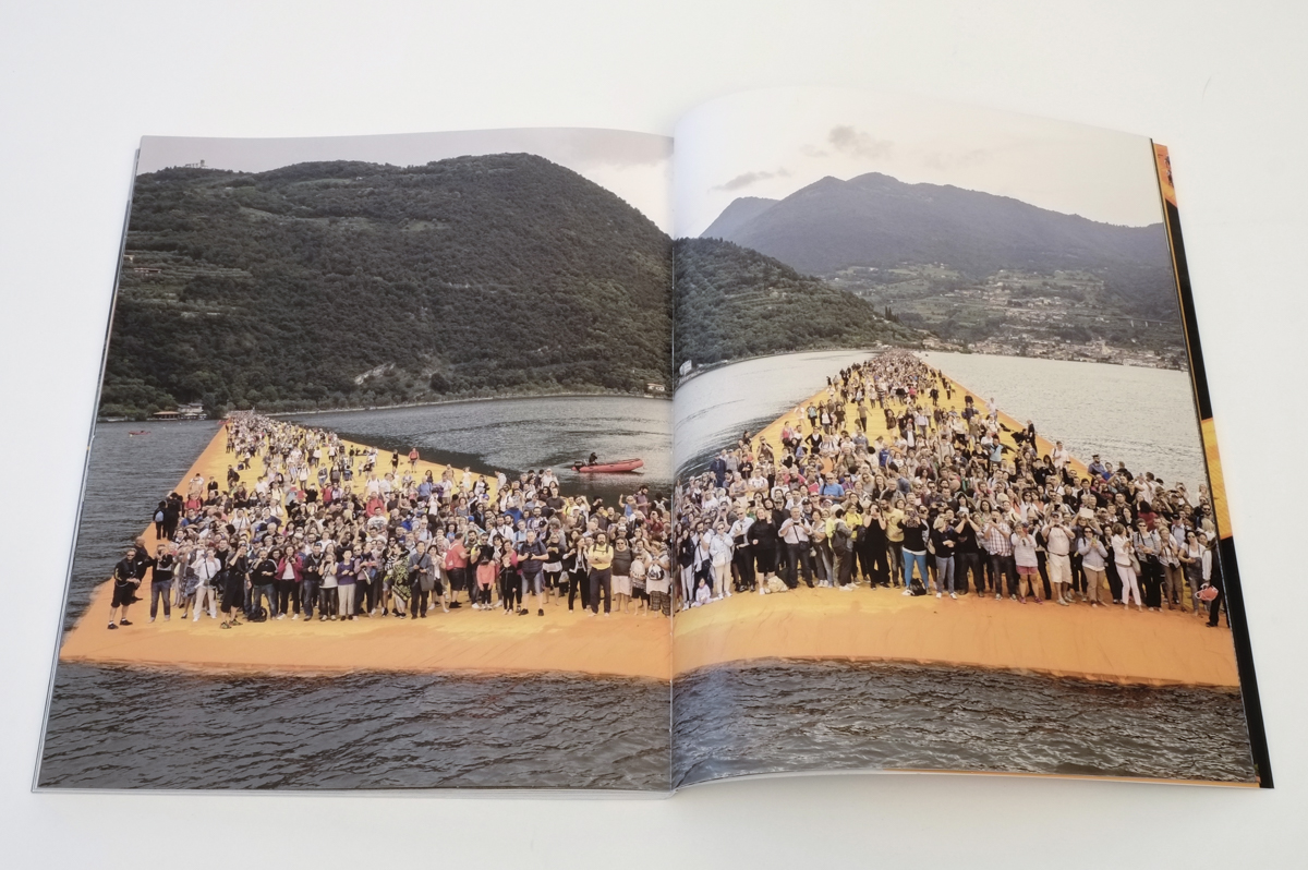 Idolatry moments - visitors taking pictures of the barge from which the artist, during one of his numerous daily tours, greets them. Christo & Jeanne-Claude - The Floating Piers - 2014-2016, pp. 120-121